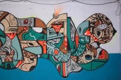 - Detalle de obra - OBRA REALIZADA PARA EL FESTIVAL RECREO. Técnica: Espray (esmalte y acrílico) + esmalte al agua (brocha y pincel) sobre muro. Medida variable. 2018
