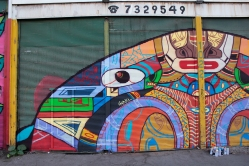 "Detalle de obra. ""OBRA MURAL PARA FESTIVAL RECREO"". Spray sobre cortina de negocio. (La vega mayorista). La Romana Lastra 966. 10 x 4 MT. 2019"